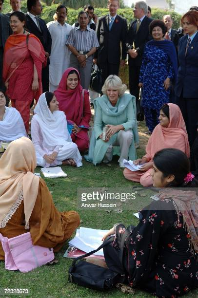 Camilla Duchess of Cornwall wearing a traditional Shalwar Kameez meets students in the grounds of the all female Fatima Jinnah University on the...