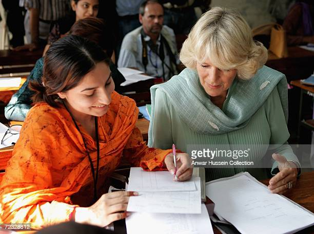 Camilla Duchess of Cornwall wearing a traditional Shalwar Kameez chats to a student at the all female Fatima Jinnah University on the third day of a...