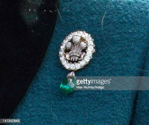 Camilla Duchess of Cornwall wears a brooch previously worn by Princess Diana as she attends day 2 'Ladies Day' of the Cheltenham Horse Racing...