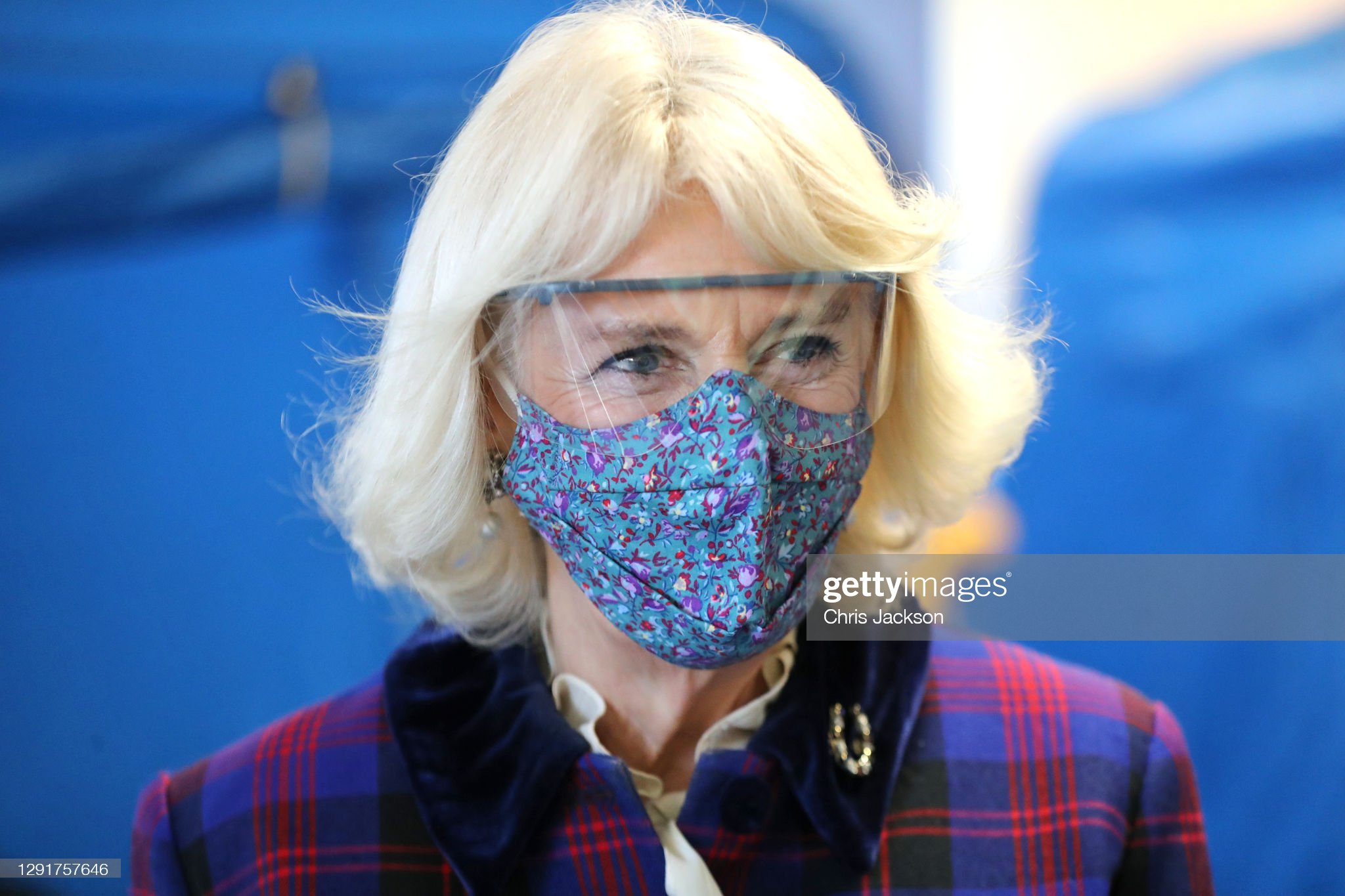 camilla-duchess-of-cornwall-wears-a-facemask-and-protective-glasses-picture-id1291757646