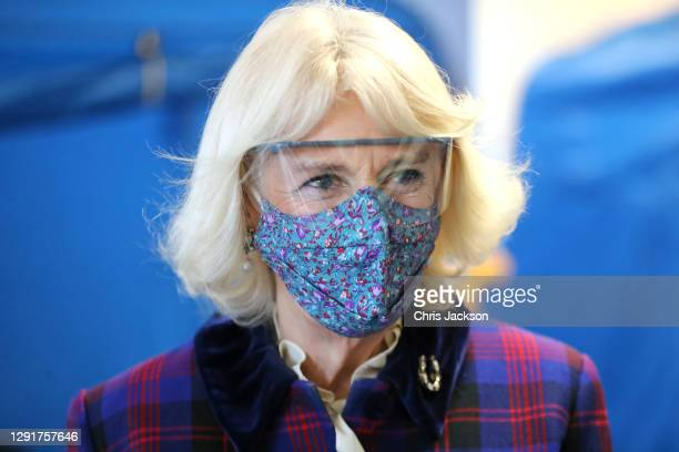 Camilla, Duchess of Cornwall wears a face-mask and protective glasses during a visit to Gloucestershire Vaccination Centre at Gloucestershire Royal...