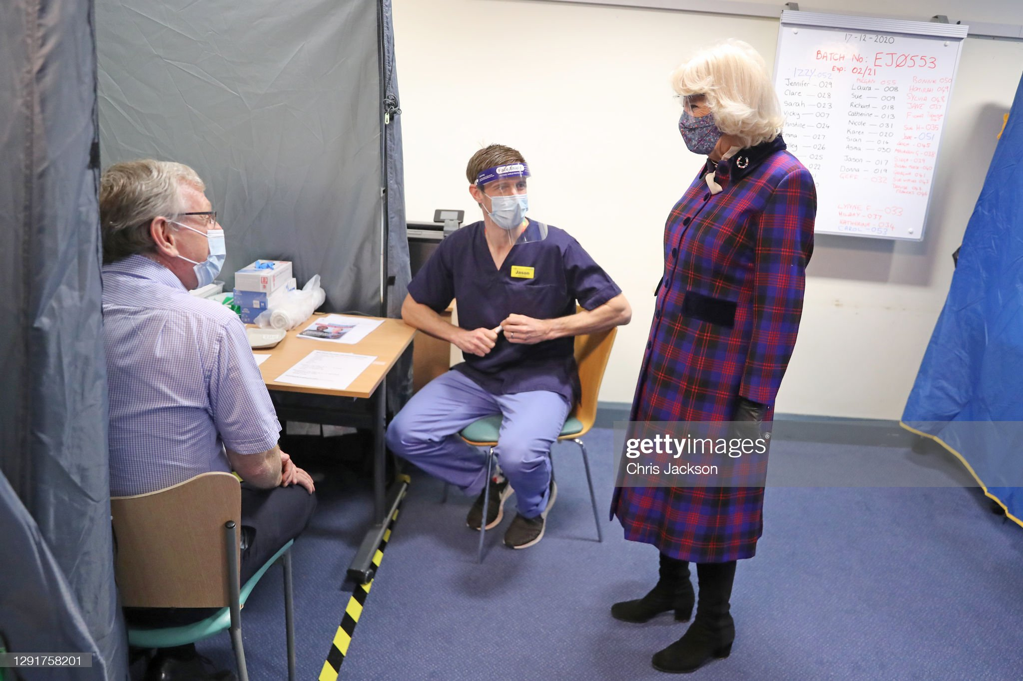 camilla-duchess-of-cornwall-wears-a-facemask-and-protective-glasses-picture-id1291758201