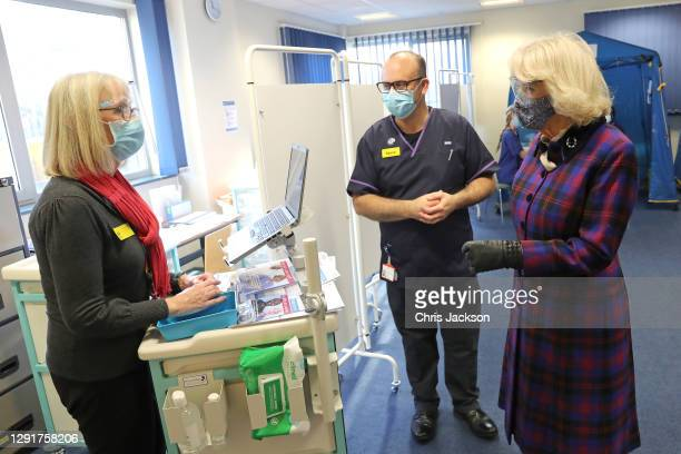 Camilla, Duchess of Cornwall wears a face-mask and protective glasses while speaking with NHS staff involved in the vaccination programme during a...