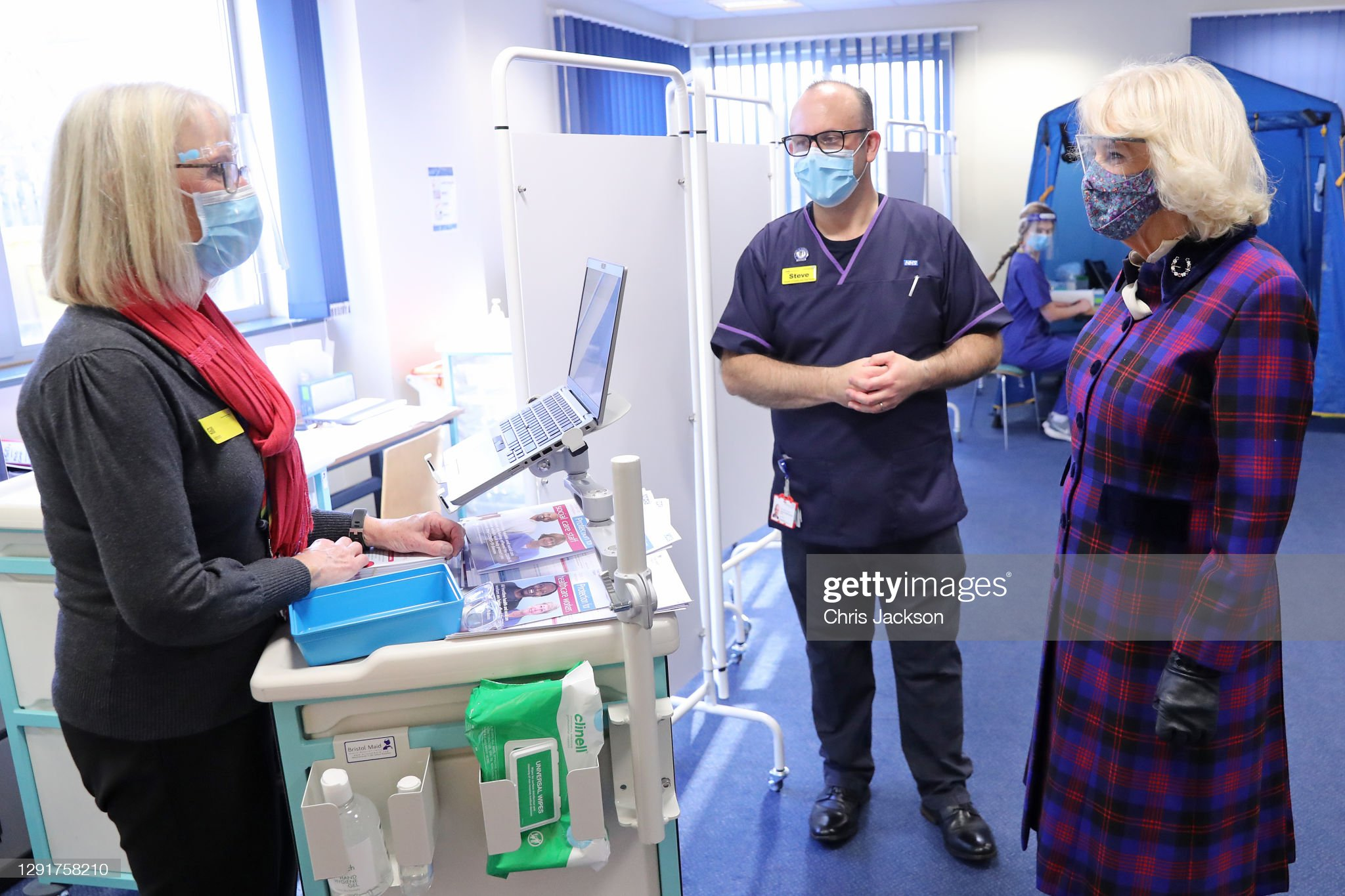 camilla-duchess-of-cornwall-wears-a-facemask-and-protective-glasses-picture-id1291758210