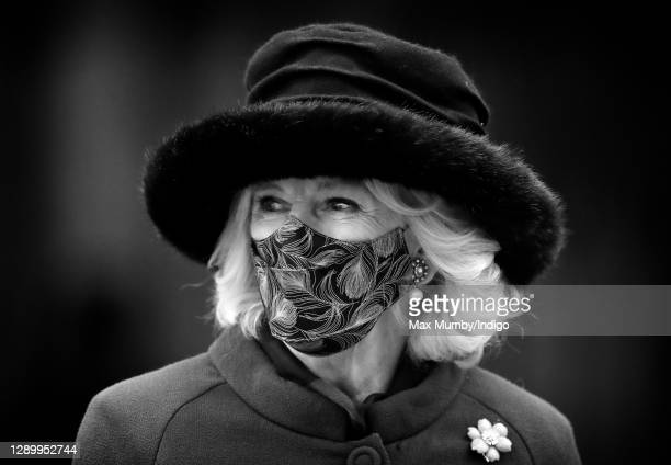 Camilla, Duchess of Cornwall wears a feather print face mask as she attends a service in celebration of the 800th anniversary of the foundation of...