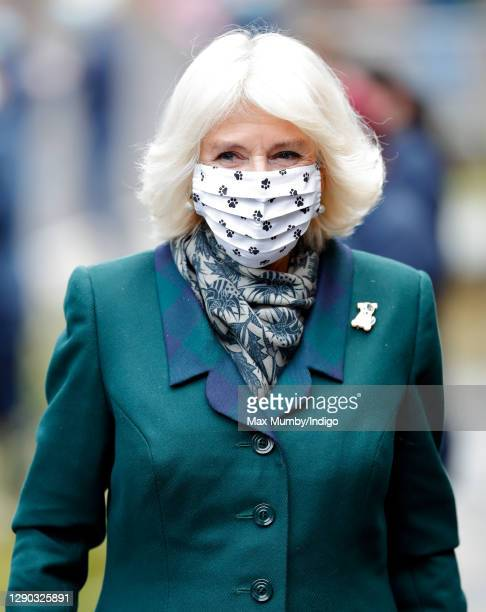 Camilla, Duchess of Cornwall wears a paw print design face mask as she visits Battersea Dogs Home to open the new kennels and thank the centre's...