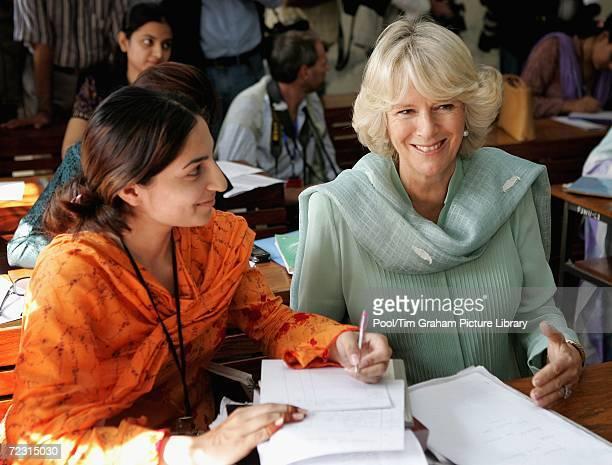 Camilla, Duchess of Cornwall wears a Shalwar kameez to meet students at the all female Fatima Jinnah University on October 31, 2006 in Rawalpindi,...
