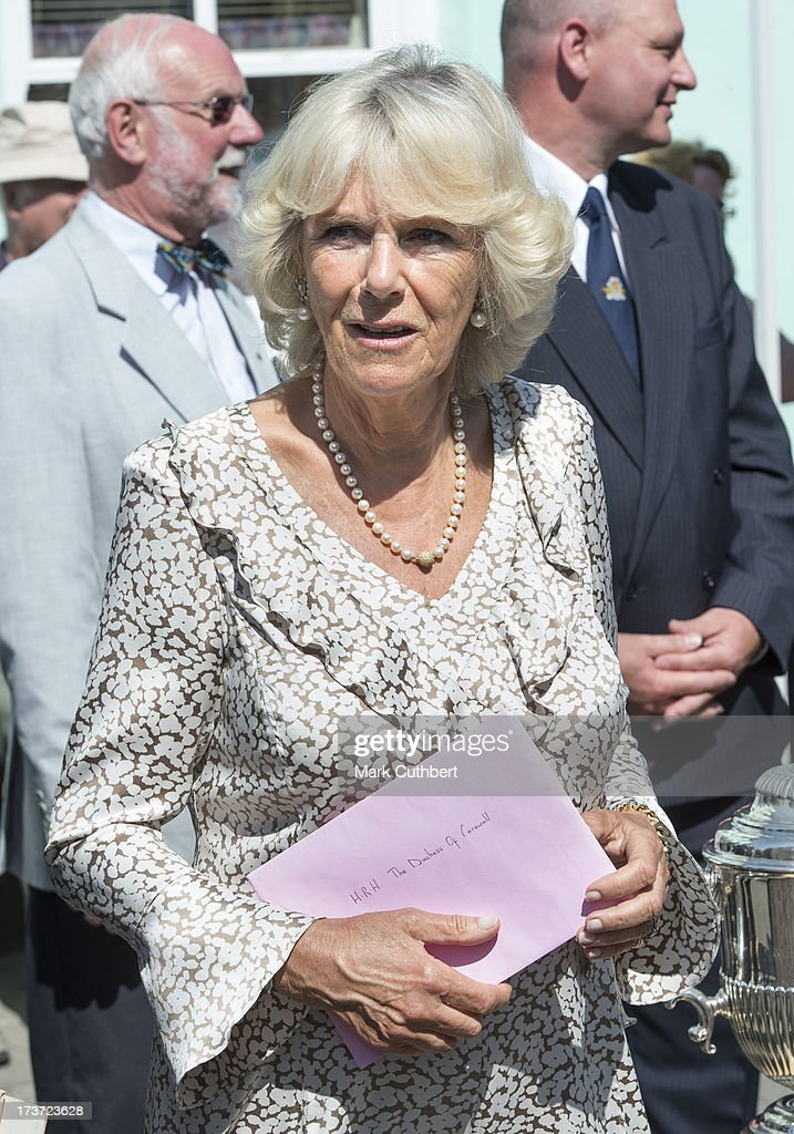 Camilla, Duchess of Cornwall, with a birthday card given to her by a well wisher on her 66th birthday, during a walkabout on a visit to Lostwithiel on July 17, 2013 in Cornwall, England.