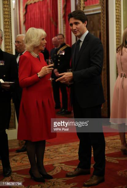 Camilla Duchess of Cornwall with Canadian Prime Minister Justin Trudeau talk at a reception for NATO leaders hosted by Queen Elizabeth II at...