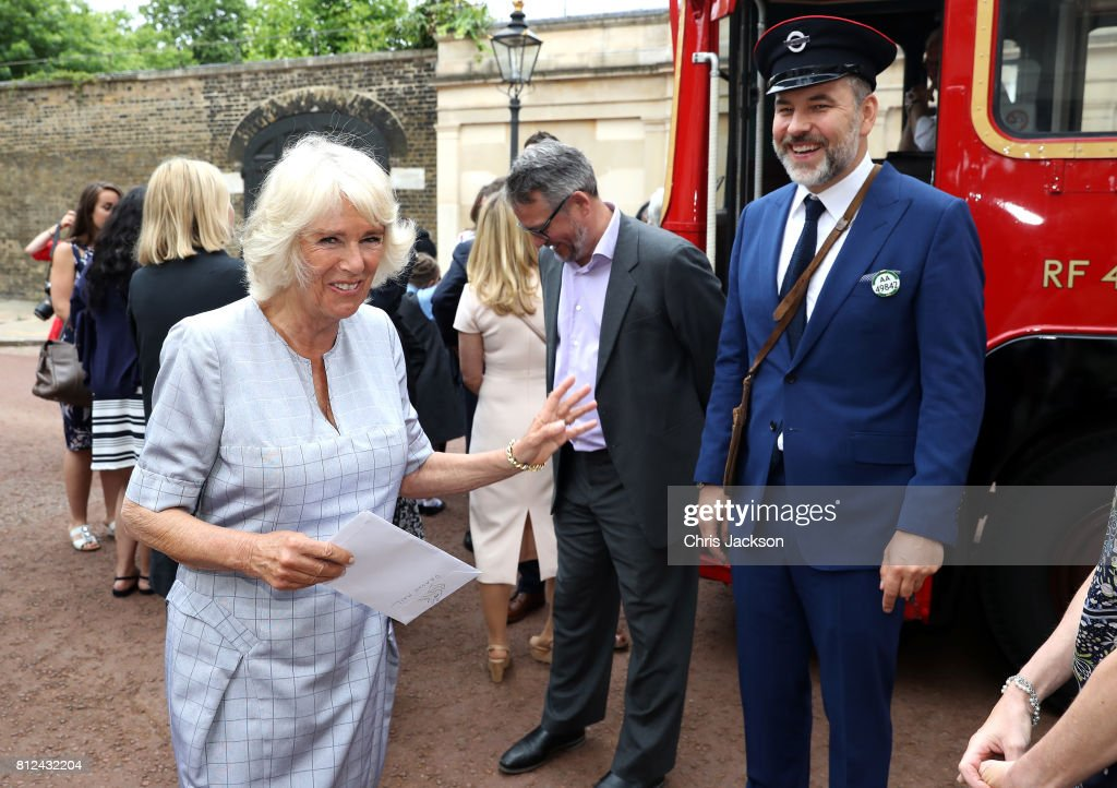 Camilla, Duchess of Cornwall with comedian and author David Walliams (R) dressed as an bus conductor, during a tea party hosted by the Duchess of Cornwall to celebrate the Duchess's Bookshelves Project at Clarence House on July 11, 2017 in London, England. The Project is an initiative to find the nation's 70 favourite children's books to mark the Duchess of Cornwall's 70th birthday.