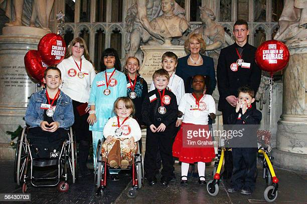 Camilla Duchess of Cornwall with the Woman's Own 'Children of Courage Awards' winners on December 14 2005 in London England The Duchess presented...