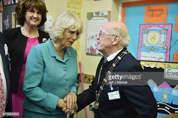 Camilla Duchess of Cornwallmeets the King of the Claddagh 84 year old Mike Lynskey during a visits to the Claddagh National School on May 19 2015 in...
