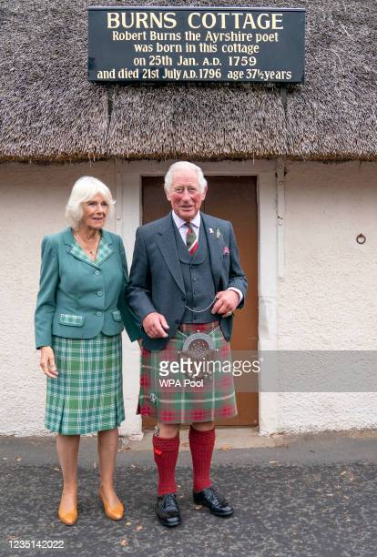 Camilla, Duchess Of Rothesay and Prince Charles, Duke of Rothesay pose in front of Robert Burn's Cottage during a visit to Alloway Main Street and...