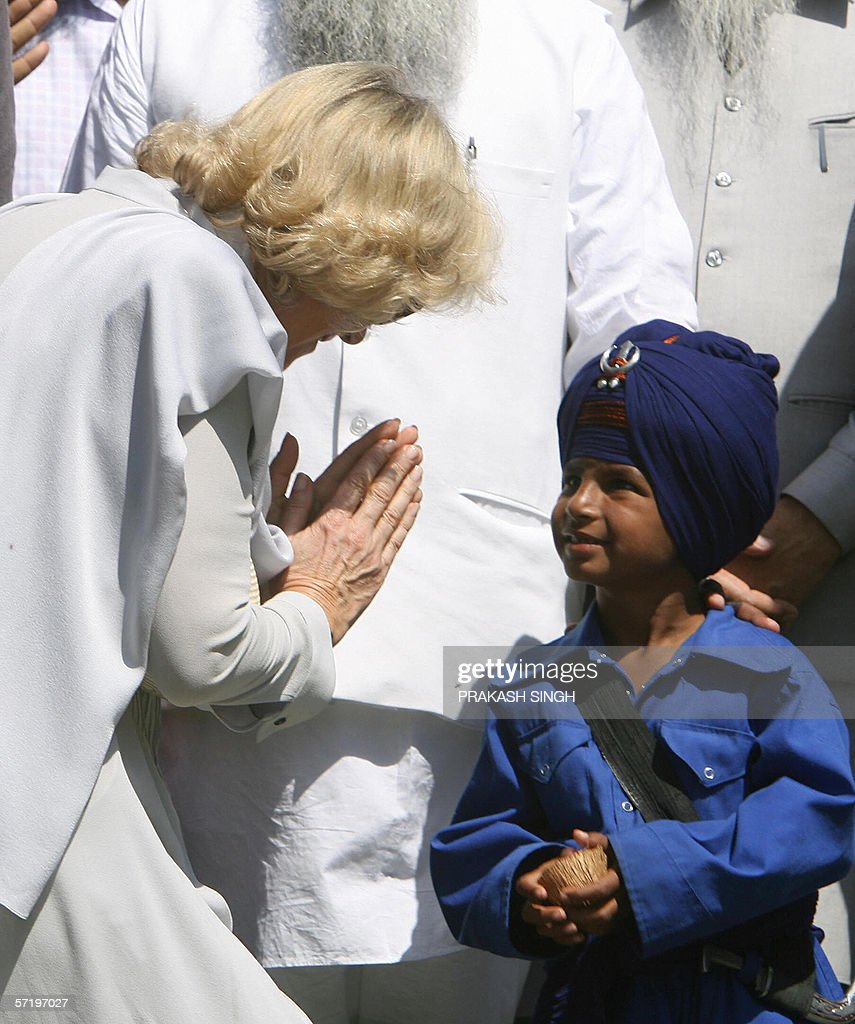 Camilla Duchess of York and wife of Britian`s Prince Charles greets a young Gatka traditional Sikh martial art player at Anadpur Saheb Gurudwara in...