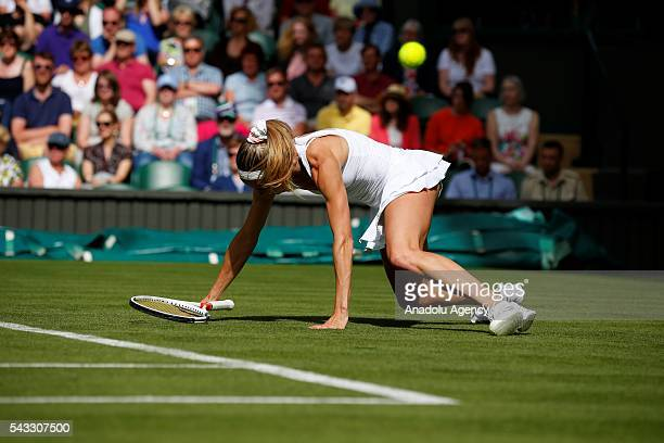 Camilla Giorgi of Italy in action against Garbine Muguruza of Spain in the womens' singles on day one of the 2016 Wimbledon Championships at the All...