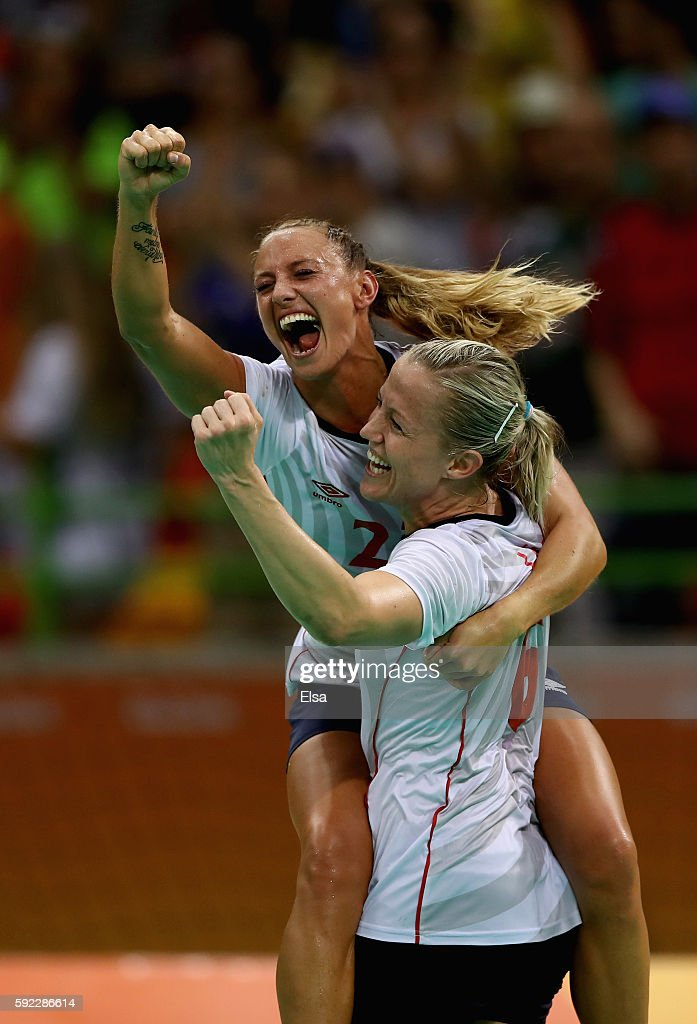 Camilla Herrem (L) and Heidi Loke of Norway celebrate their victory following the Women's Handball Bronze medal match between Netherlands and Norway at Future Arena on Day 15 of the Rio 2016 Olympic Games at the Future Arena on August 20, 2016 in Rio de Janeiro, Brazil.