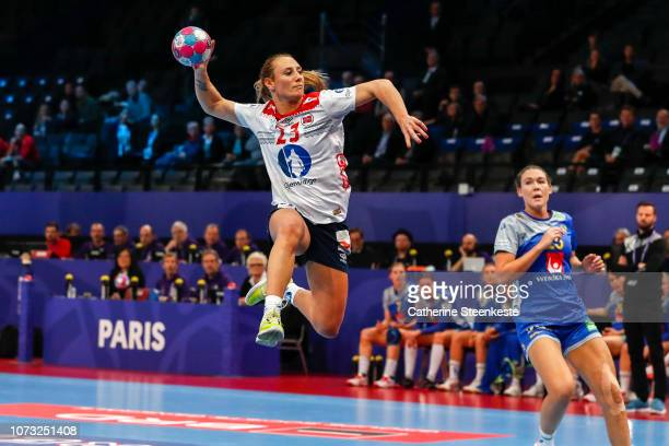 Camilla Herrem of Norway jumps to shoot the ball during the EHF Euro match for the classification 56 between Sweden and Norway at AccorHotels Arena...