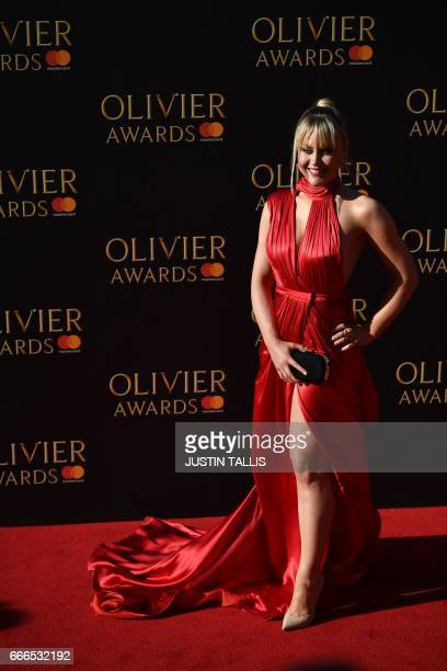 Camilla Kerslake poses on the red carpet upon arrival to attend the 2017 Laurence Olivier Awards in London on April 9 2017 / AFP PHOTO / JUSTIN TALLIS