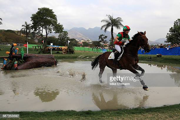 Camilla Kruger of Zimbabwe riding Biarritz competes during the Cross Country Eventing on Day 3 of the Rio 2016 Olympic Games at the Olympic...
