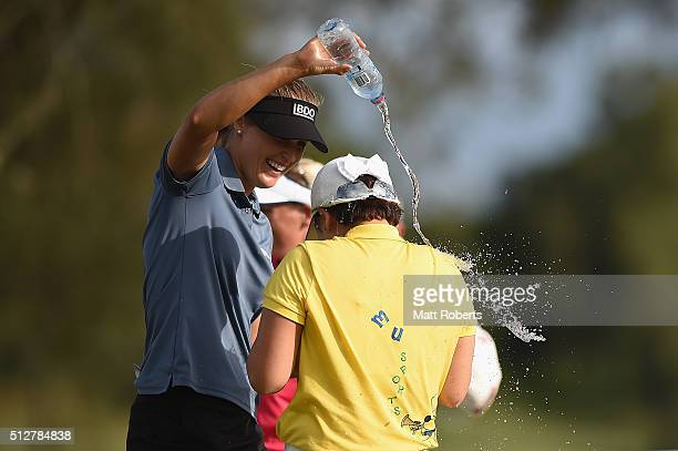 Camilla Lennarth of Sweden pours water on tournament winner Jiyai Shin of South Korea during day four of the RACV Ladies Masters at Royal Pines...