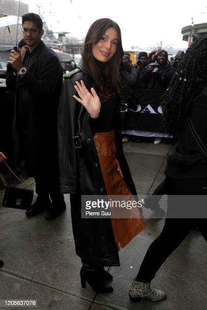 """Camilla Morrone arrives at the""""Coach"""" show during New York Fashion Week on February 11, 2020 in New York City."""