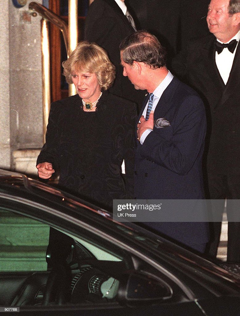 Camilla Parker Bowles and Prince Charles walk out of the Ritz January 28, 1999. More than 100 photographers took up positions outside London's Ritz hotel for the most elusive shot of all -- Prince Charles together with his long-time lover Camilla Parker Bowles.