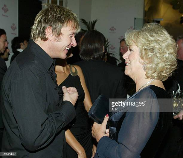 Camilla Parker Bowles speaks with singer Simon Le Bon during the reception at the 'Fashion Rocks' concert and fashion show 15 October 2003 in aid of...