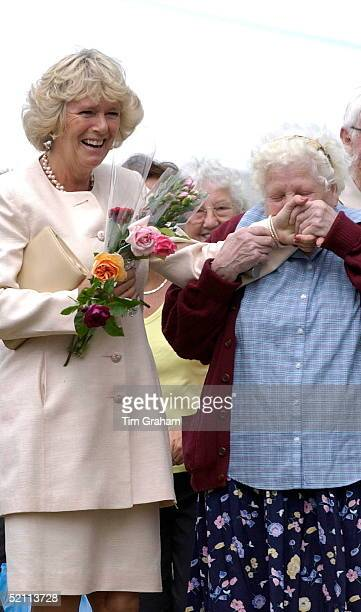 Camilla Parkerbowles Laughing At The Sandringham Flower Show As A Woman In The Crowd 77 Yearold Dorothy Edwards Kisses Her Hand She Is Holding Some...