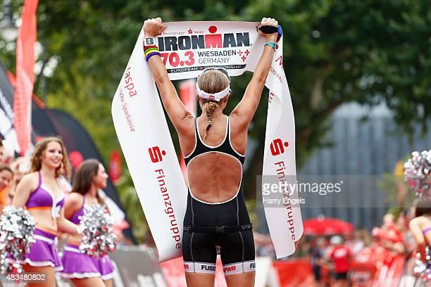 Camilla Pedersen of Denmark celebrates winning the Women's Wiesbaden Ironman 703 on August 9 2015 in Wiesbaden Germany