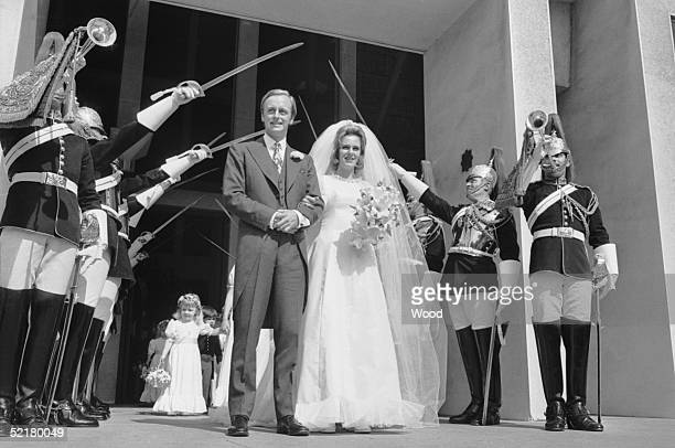 Camilla Shand and Major Andrew Parker-Bowles pass through the Guard of Honour after their wedding at the Guards Chapel, Wellington Barracks, 4th July...