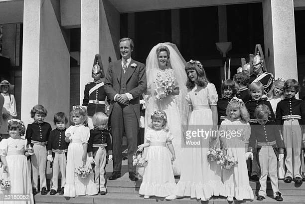 Camilla Shand and Major Andrew Parker-Bowles pose with their pageboys and bridesmaids after their wedding at the Guards Chapel, Wellington Barracks,...