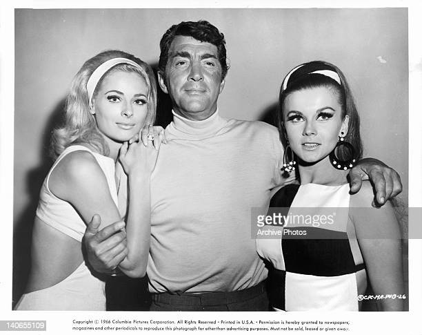 Camilla Sparv and Dean Martin pose with unknown actress in a scene from the film 'Murderers' Row' 1966