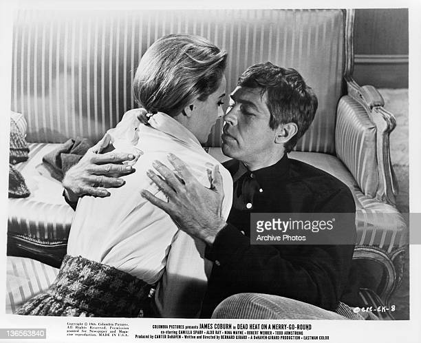 Camilla Sparv and James Coburn embrace in a scene from the film 'Dead Heat On A MerryGoRound' 1966