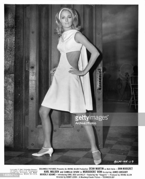 Camilla Sparv poses with hands on hips in a scene from the film 'Murderers' Row' 1966
