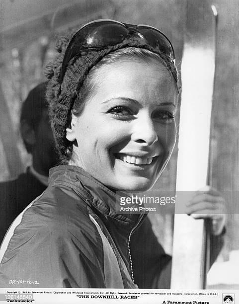 Camilla Sparv smiling in ski attire in a scene from the film 'The Downhill Racer' 1969