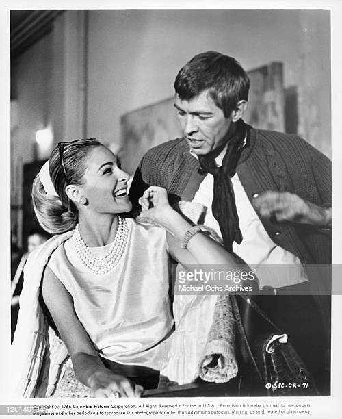 Camilla Sparv smiling while looking up at James Coburn in a scene from the film 'Dead Heat On A Merry Go Round' 1966