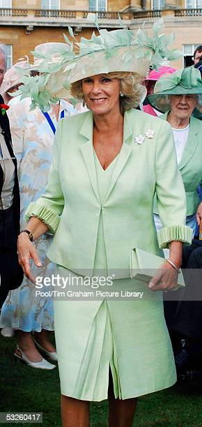 Camilla, The Duchess Of Cornwall, attends her first Buckingham Palace garden party since her marriage to Prince Charles on July 19, 2005 in London.