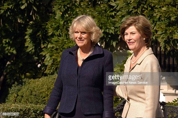 Camilla the Duchess of Cornwall left and US first lady Laura Bush greet the media as Britain's Prince Charles and President George W Bush meet at the...