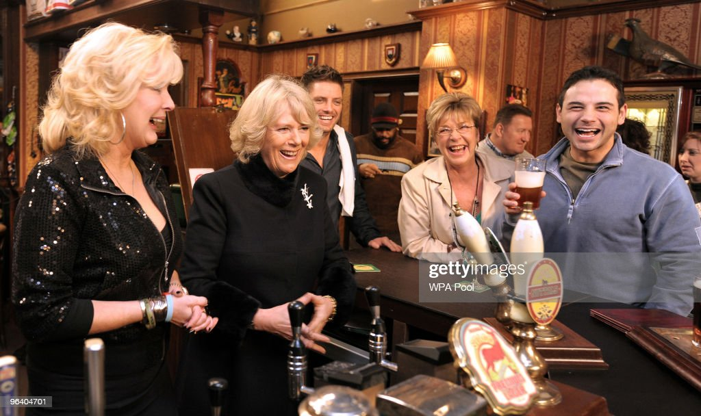 Camilla, The Duchess of Cornwall (2nd L) meets actors Beverly Callard, who plays landlady Liz McDonald (L), Anne Kirkbride, who plays the role of Deirdre Barlow (2nd R) and Ryan Thomas, who plays the role of Jason Grimshaw (R) during a visit to the Rovers Return Pub during a tour of the Coronation Street set on February 4, 2010 in Manchester, England.