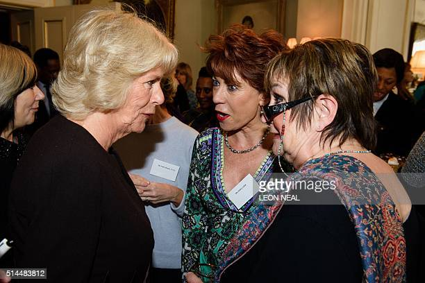 Camilla the Duchess of Cornwall President of WOW speaks with the author Kathy Lette and British journalist Jenni Murray at a reception for the Women...