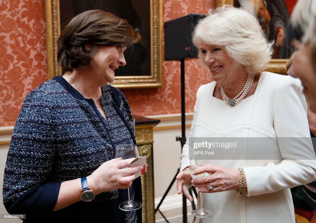 Camilla, the Duchess of Cornwall speaks to Cherie Blair as she hosts a Women of the World reception at Buckingham Palace on March 8, 2017 in London, England.