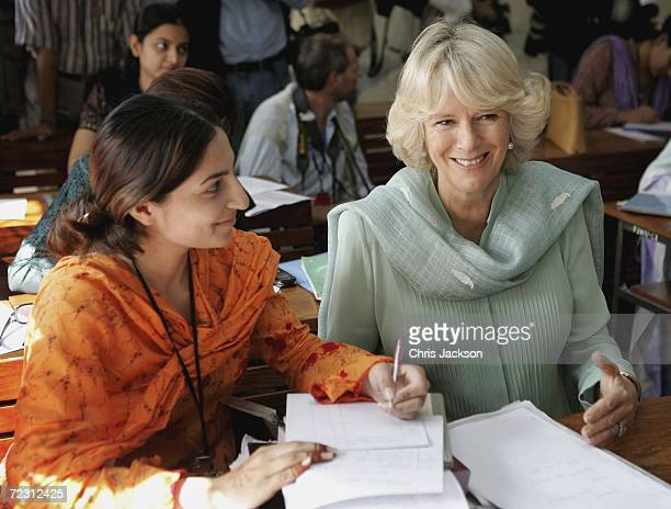 Camilla the Duchess of Cornwall talks to a pupil in the public administration lesson at Fatima Jinnah college October 31 2006 in Islamabad Pakistan