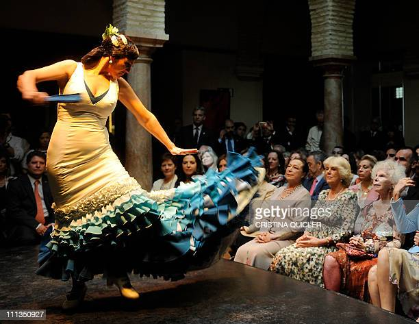 Camilla wife of Britain's Prince Charles and the Duchess of Alba watch the dancer Cristina Hoyos' flamenco performance during the first official...