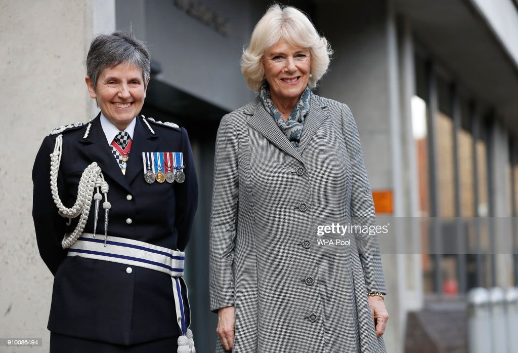 Camilla,Duchess of Cornwallis accompanied by Metropolitan Police Commissioner Cressida Dick as she visits the Metropolitan Police Service Base to learn about TecSOS, a technological innovation used to protect victims of domestic violence, on January 25, 2018, in London, England.