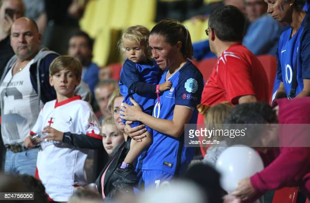 Camille Abily of France gets her child in the stands following the UEFA Women's Euro 2017 quarter final match between England and France at Stadion...