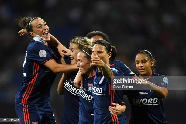 Camille Abily of Lyon celebrates scoring her sides fourth goal with team mates during the UEFA Womens Champions League Final between VfL Wolfsburg...