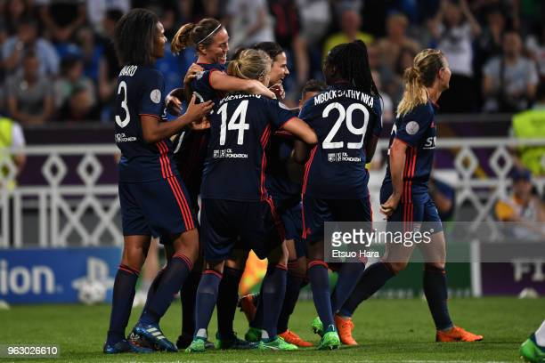 Camille Abily of Olympique Lyonnais celebrates scoring her side's fourth goal with her team mates during the UEFA Womens Champions League Final...