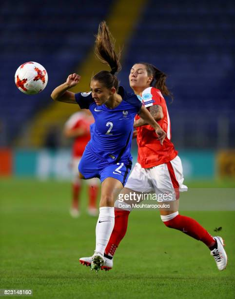 Camille Abily of Switzerland and Eve Perisset of France compete for the ball during the Group C match between Switzerland and France during the UEFA...