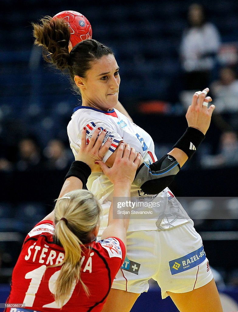 Camille Ayglon (R) of France is challenged by Helena Sterbova (L) of Czech Republic during the Women's European Handball Championship 2012 Group I main round match between Czech Republic and France at Arena Hall on December 11, 2012 in Belgrade, Serbia.