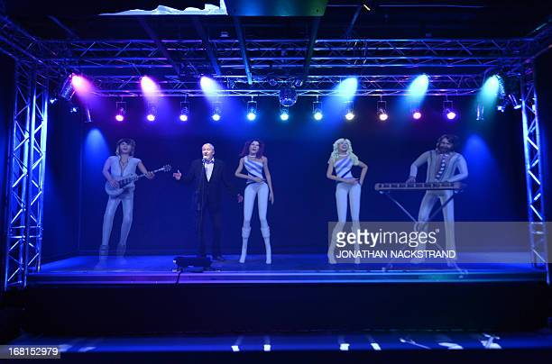 Camille BASWOHLERT This picture taken on May 6 2013 in Stockholm shows a man singing karaoke with a hologram featuring ABBA members at world's first...